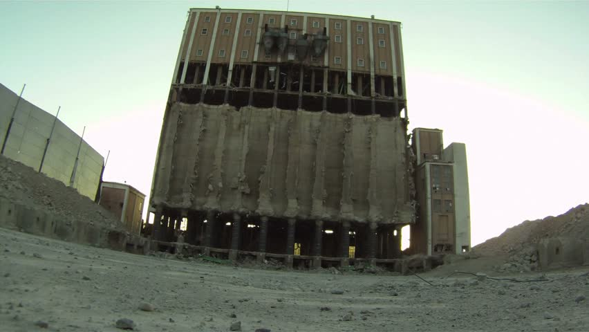 Building implosion danger close