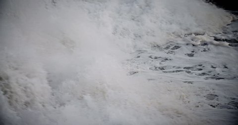 Large waves roll into the coast of Hawaii in slow motion. (Hawaii 2010s)