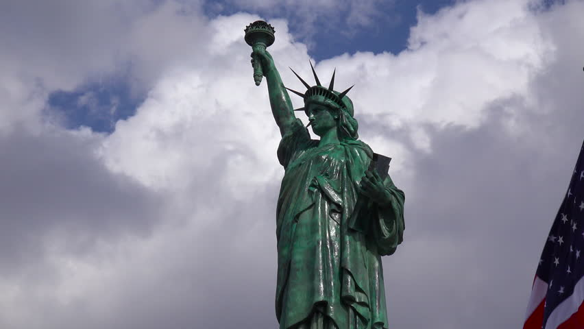 A patriotic shot of the Statue Of Liberty against a cloudy sky. (Alabama 2010s) | Shutterstock HD Video #18687335