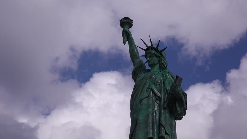 A patriotic shot of the Statue Of Liberty against a cloudy sky. (Alabama 2010s) | Shutterstock HD Video #18687341