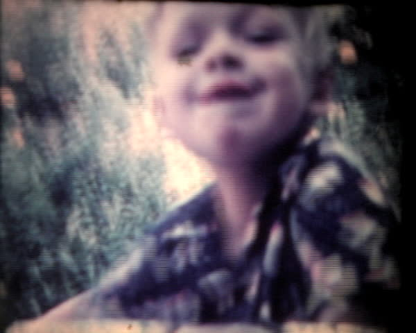 Boy on bike, vintage 8mm film footage.