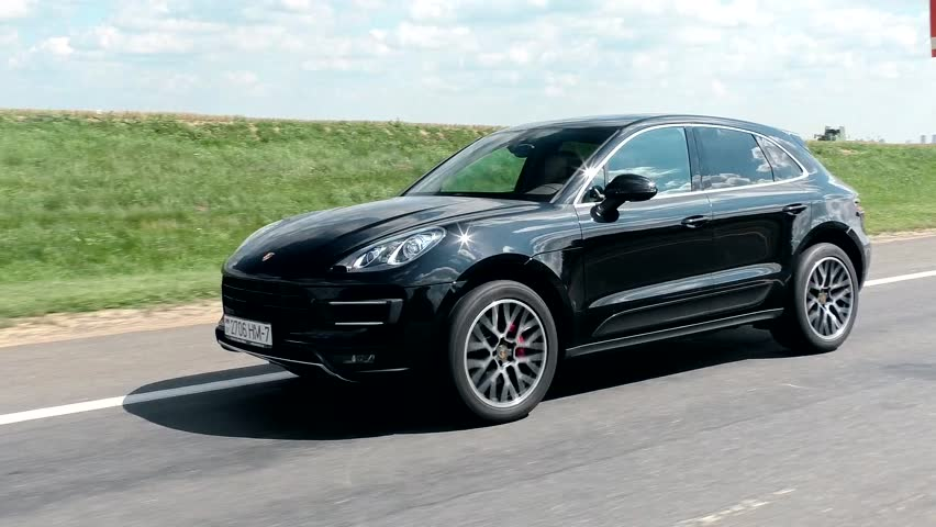 MINSK, BELARUS - AUGUST 5, 2016: Porsche Macan Turbo at the test-drive. Extreme driving on a curve. 3 shots of car SUV skidding