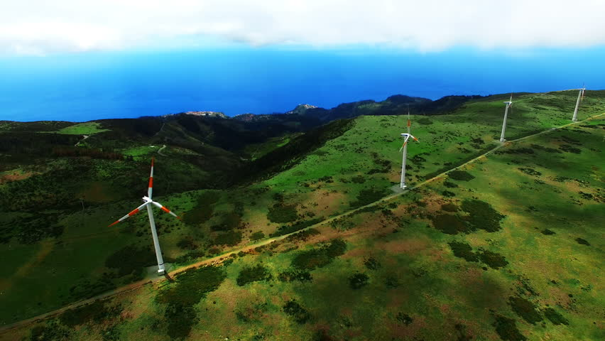 Portugal Madeira ECO countryside landscape alternative energy 4k time-lapse travel video background. Aerial flight over hills, wind farm turbines, ocean #18710945