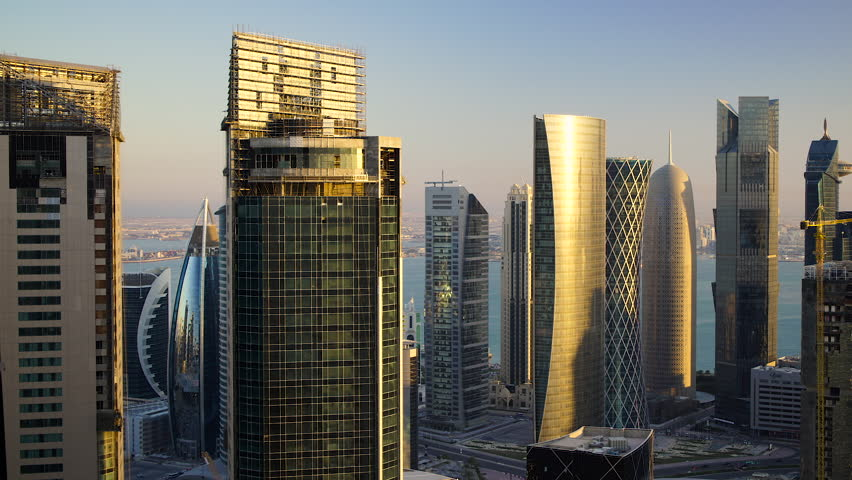 Panning across the new skyline of the West Bay central financial district of Doha, at sunset, Doha. Qatar, Middle East | Shutterstock HD Video #18725696