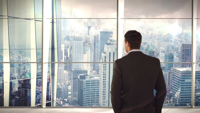 Rear view of businessman standing and looking at office window | Shutterstock HD Video #18728000