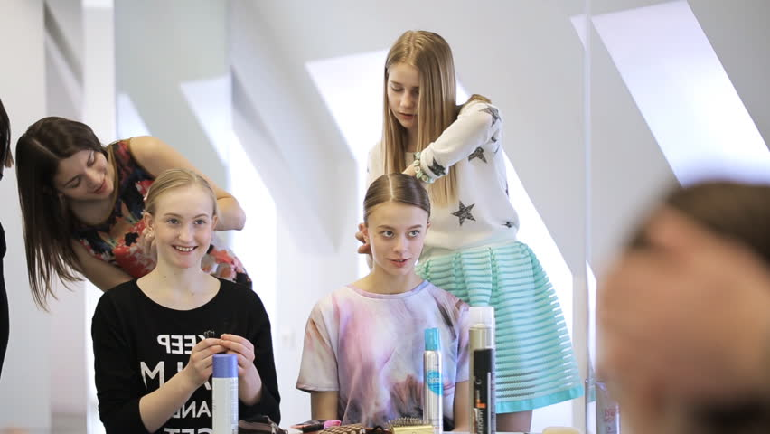 Stylists create hairstyle for pretty girls in white studio | Shutterstock HD Video #18768935