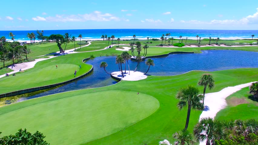 Aerial - Beautiful view of Golf Course next to ocean panning across