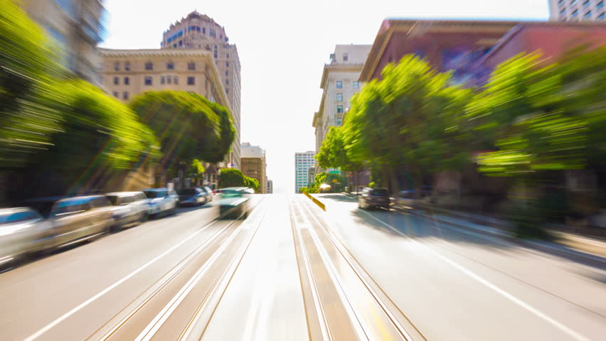 SAN FRANCISCO, MAY 19, 2016: Original time-lapse first person POV of fast moving traffic, passing pedestrians and city riding inside front of outbound California Street cable car on a sunny summer day