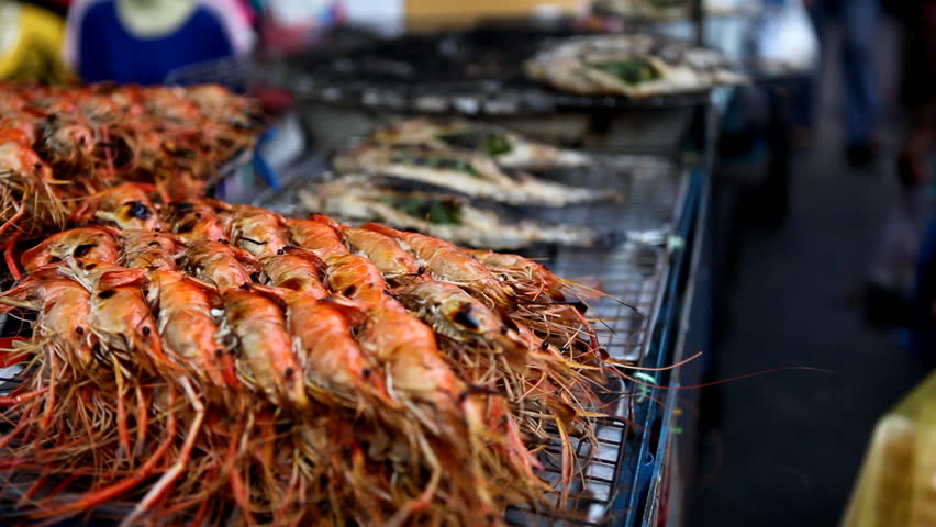 A lot of grilled shrimps and fish on the street of Bangkok, Thailand   Shutterstock HD Video #1885918