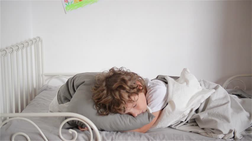 Overslept boy does not want to wake up, child falls out of bed | Shutterstock HD Video #18875681