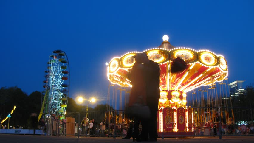 People ride on shone chairoplane in night, time lapse Royalty-Free Stock Footage #1889803