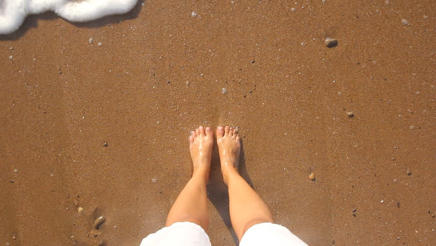 feet in the sand on the beach #18912593