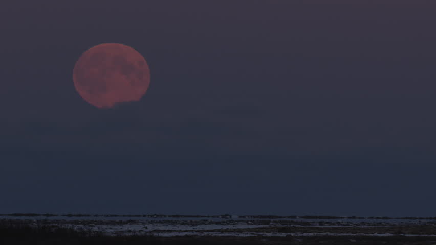 Full moon emerges from clouds over tundra in arctic - A001 C137 102972 001 | Shutterstock HD Video #18914420