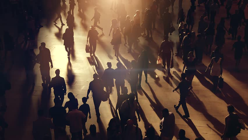 silhouette of anonymous people walking in the city. business commuters traveling background. urban metropolis lifestyle scenery