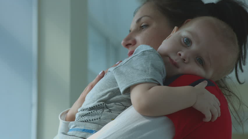 Mom soothes baby in her arms