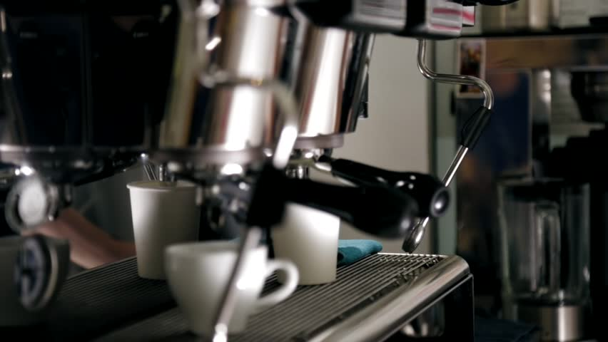 Barista runs , whips and heats the milk for my coffee   Shutterstock HD Video #18957464