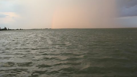 The lake in the setting sun before the impending storm.