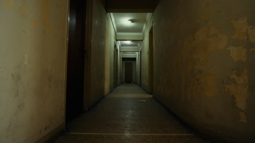 4K Old apartment building,long dark hallway pov track-in,walking.Tracking in on the corridor of an old apartment building,long and dark hallway.