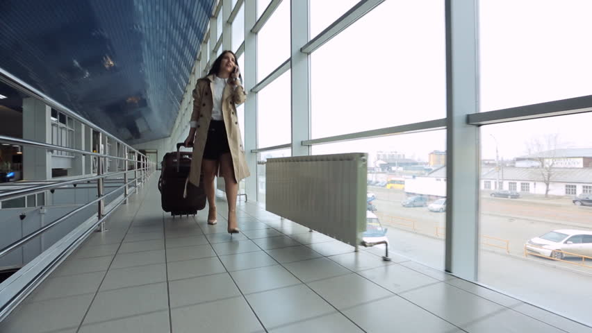 Young and beautiful woman is walking airport hall. | Shutterstock HD Video #19006942