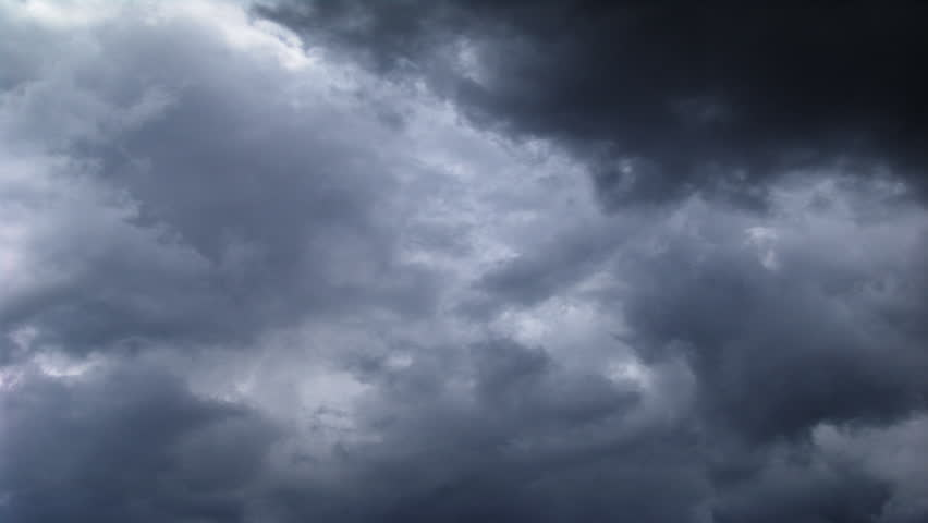 An HD time lapse of clouds against a dark blue sky.