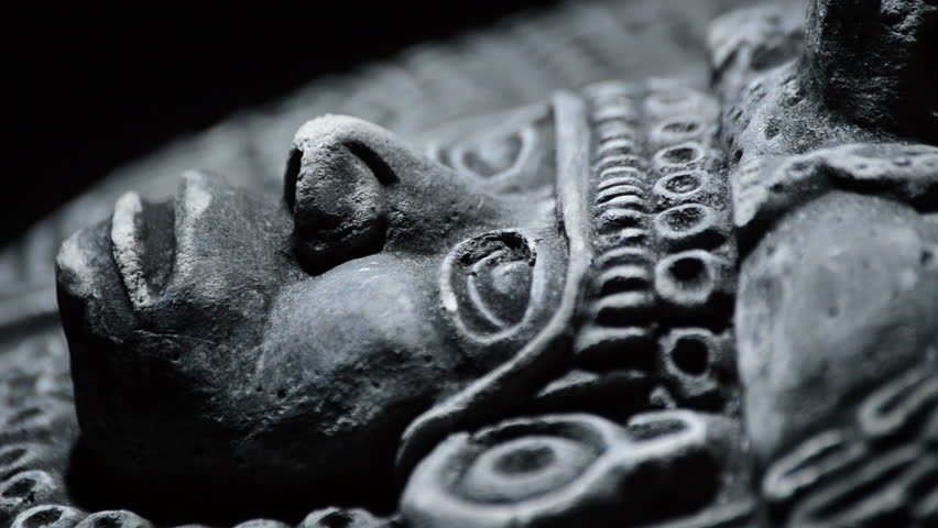 Sculpture in stone of face and ornaments of ancient art south american aztec, inca, olmeca | Shutterstock HD Video #19013284