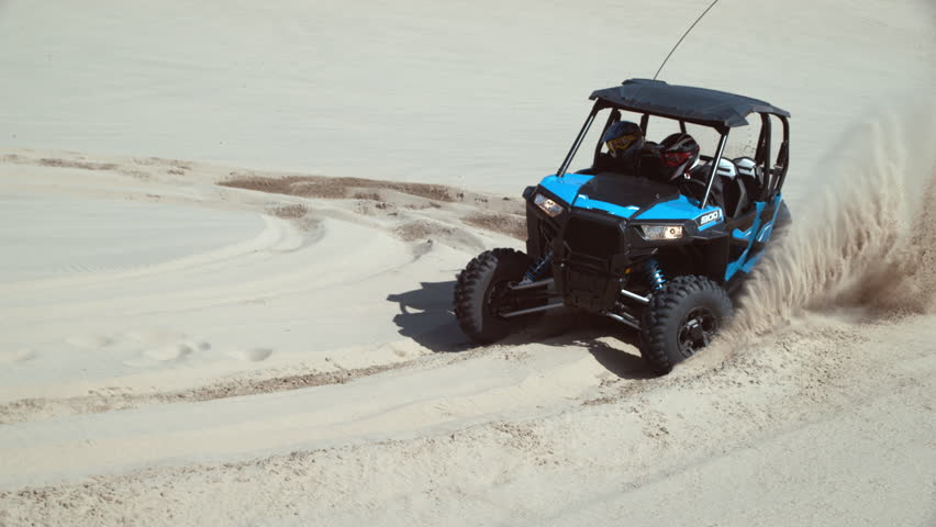 Super slow motion shot of ATV driving on sand dunes, Oregon, shot with Phantom Flex 4K