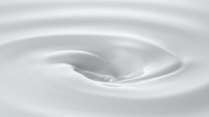 Milk droplets falling into swirl of milky liquid. Shot with high speed camera, phantom flex 4K. Slow Motion. Unedited version is included at the end of clip.