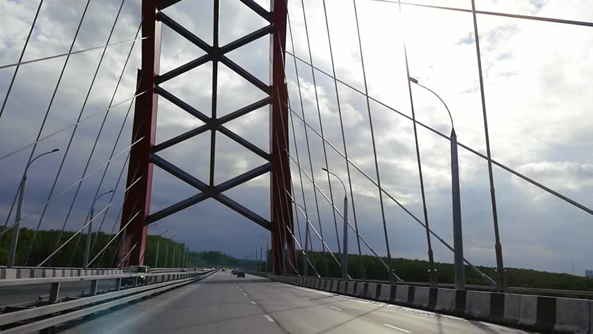 Road through the bridge with cloudy sky and moving cars in slowmotion. 1920x1080 #19061266