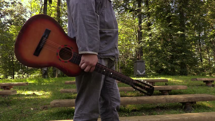 Man with guitar in park  | Shutterstock HD Video #19078498