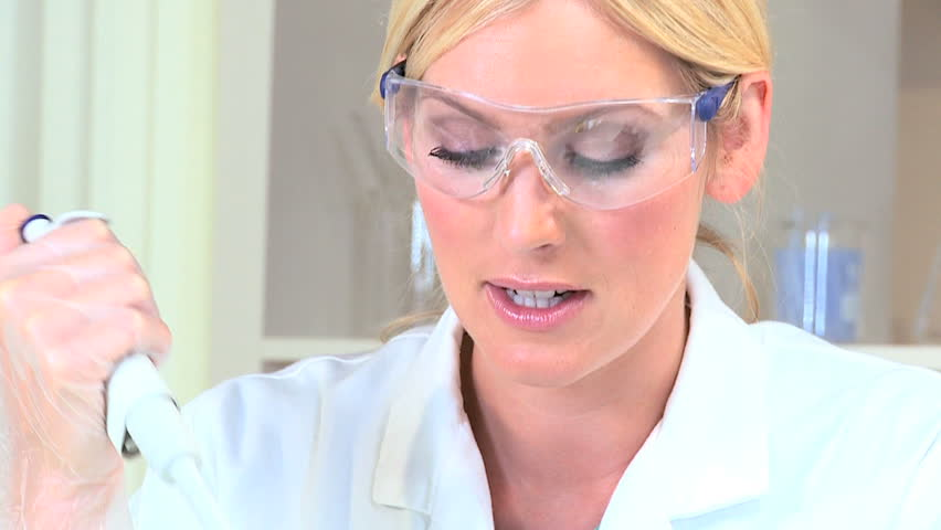 Female medical researcher working with sterile equipment | Shutterstock HD Video #1907977