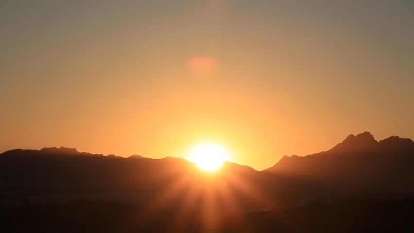 Time lapse of beautiful sunrise over mountain