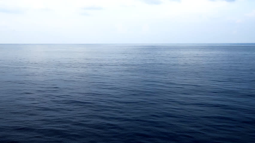 Peaceful and calm shot of a gently lapping sea and nice sky with cloud?view from forward point of open deck of a cruise ship. | Shutterstock HD Video #19084453