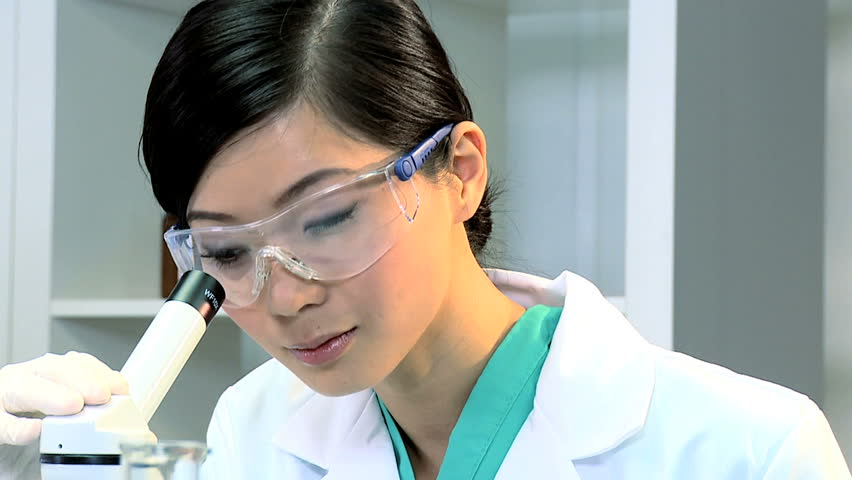Asian chinese medical student in protective mask and glasses checking research results | Shutterstock HD Video #1910593