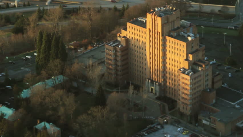 Evening sunlight on the top of a hospital complex from overhead