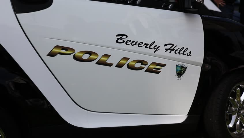 BEVERLY HILLS, CALIFORNIA, USA - OCTOBER 14, 2011 : Unidentified police officers watch the order at the annual craft show on October 14, 2011 in Beverly Hills, California. | Shutterstock HD Video #1914202