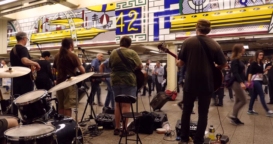NEW YORK CITY - CIRCA MAY 2015: Band of street musician performing in Times square - 42nd St. subway station.