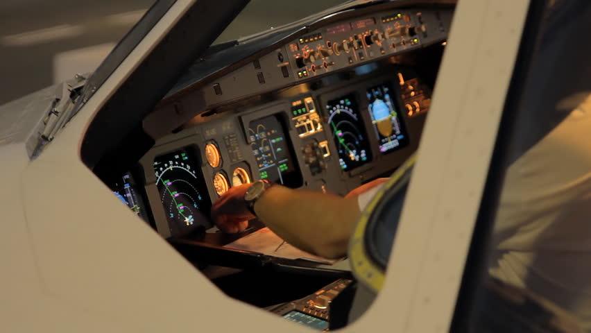 Airplain pilot in cockpit doing filght preparations