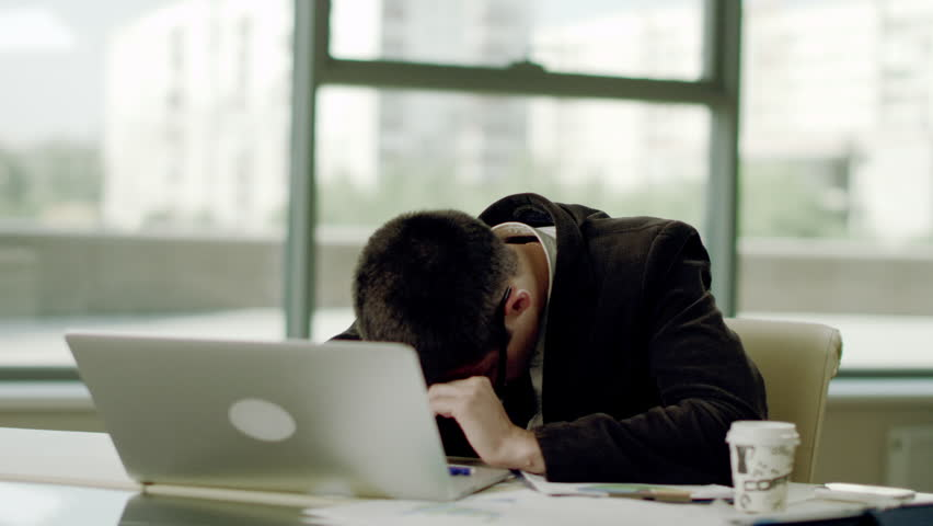 Sleeping at working place   Shutterstock HD Video #19169320