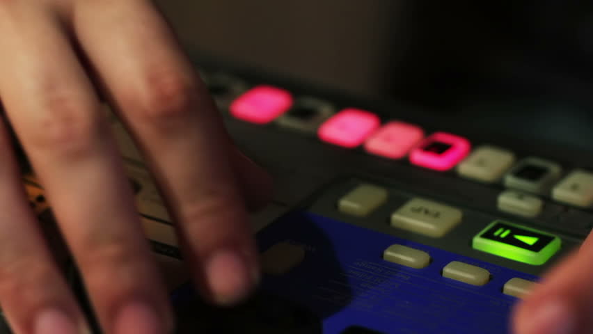 DJ creating music on an analog synthesizer | Shutterstock HD Video #1917583