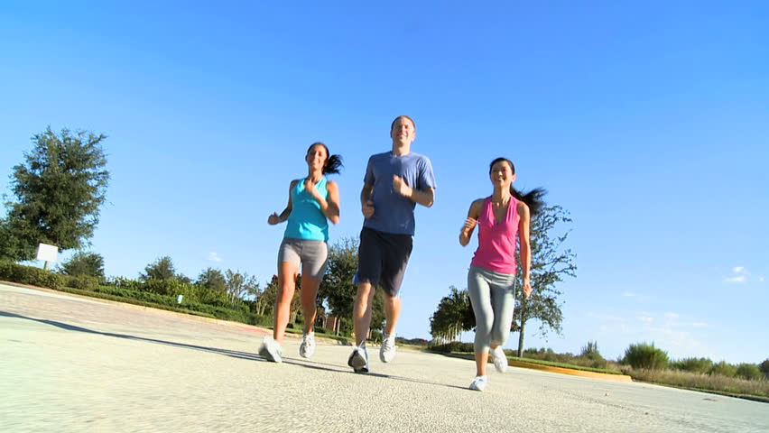Group of young people jogging on suburban roads for sporting event