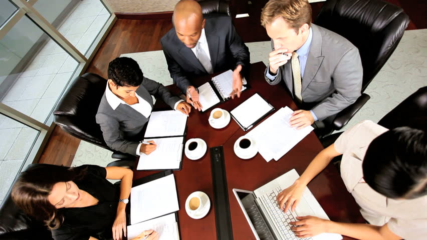 Overhead shot of multi ethnic business executives being motivated by their team leader in a boardroom meeting | Shutterstock HD Video #1924696