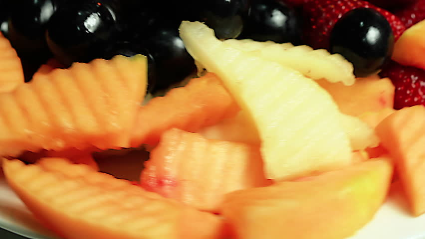 Close-up of a rotating fresh fruit plate. Loopable.