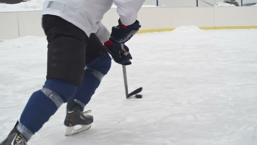 Tracking rear view of forward player dribbling puck with stick then scoring goal and celebrating while goaltender protecting teams net with butterfly technique in slow motion | Shutterstock HD Video #19253575
