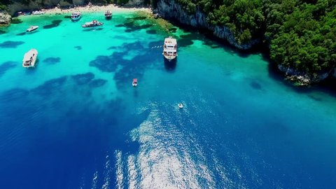 Tropical Ionian Greece Blue Lagoon island Aerial 4k travel video. Ocean sea forest coast seashore, water, yacht boat