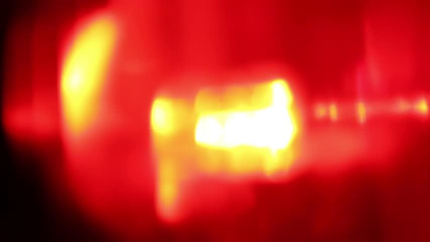 Flashing red LED light, extreme close-up