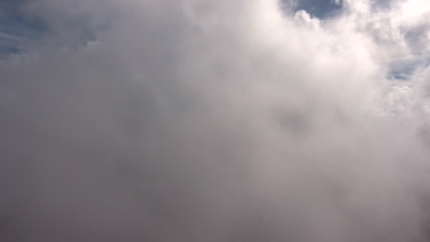 Aerial shooting from flying drone though a beautiful puffy grey clouds with sun rays over blue sky. Wonderful dramatic overcast  #19297960