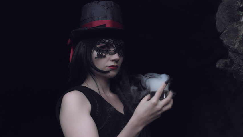 4k Halloween Shot of a Witch Drinking Poison with Smoke   Shutterstock HD Video #19314637
