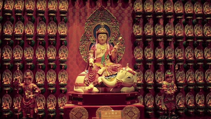 SINGAPORE - CIRCA JAN 2015: Many religious statues at the Buddha Tooth Relic Temple in Singapore. 4k UltraHD footage   Shutterstock HD Video #19330705