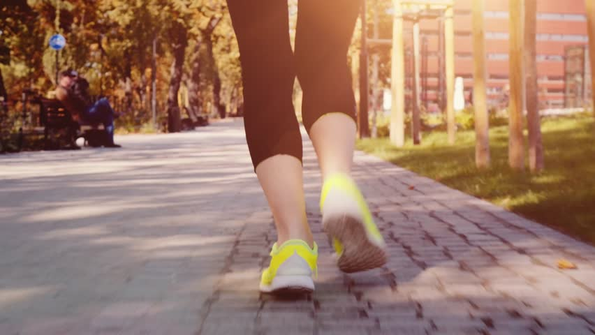 Runner Woman Feet in the City Exercising Outdoors, 4K CLOSE UP. Steadicam STABILIZED shot. Young Sportswoman in barefoot Sports Shoes training on the sunny city park road. Healthy Lifestyle #19337182