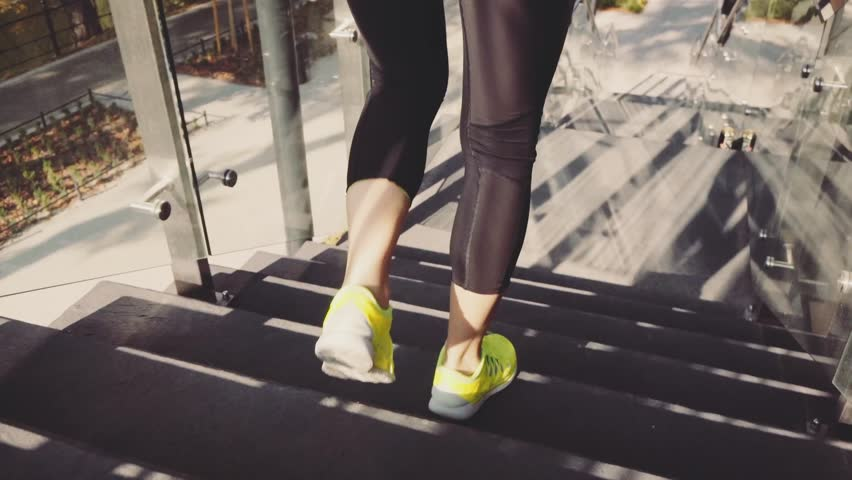 Runner Woman Jogging down Stairs, Lens Flare. SLOW MOTION 120 fps Steadicam STABILIZED shot. Athletic Sportswoman Running down the Modern Sunny Glass Stairs. Healthy Lifestyle and Wellness.   #19344067